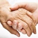 elderly hand holding